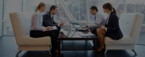 Two Men Two Women in Business Meeting | TeleMed Inc.