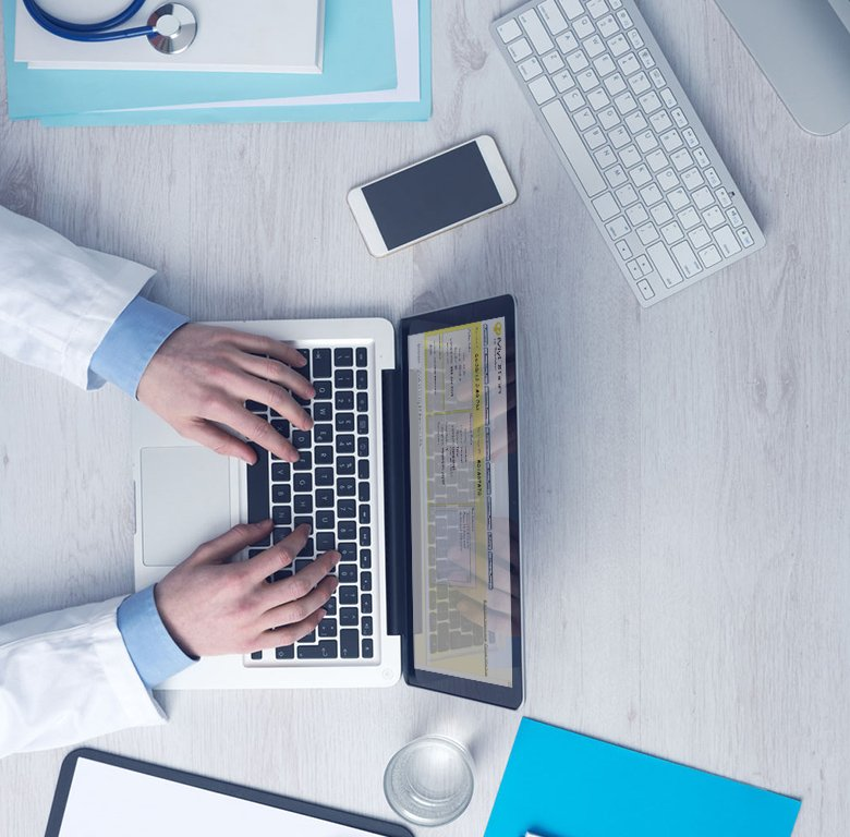 Doctor on Laptop IntraOffice | TeleMed Inc.