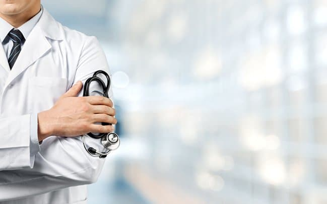 Doctor holding stethoscope | IntraOffice | TeleMed Inc.