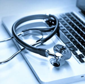 Stethoscope on Doctor Laptop | TeleMed Inc.