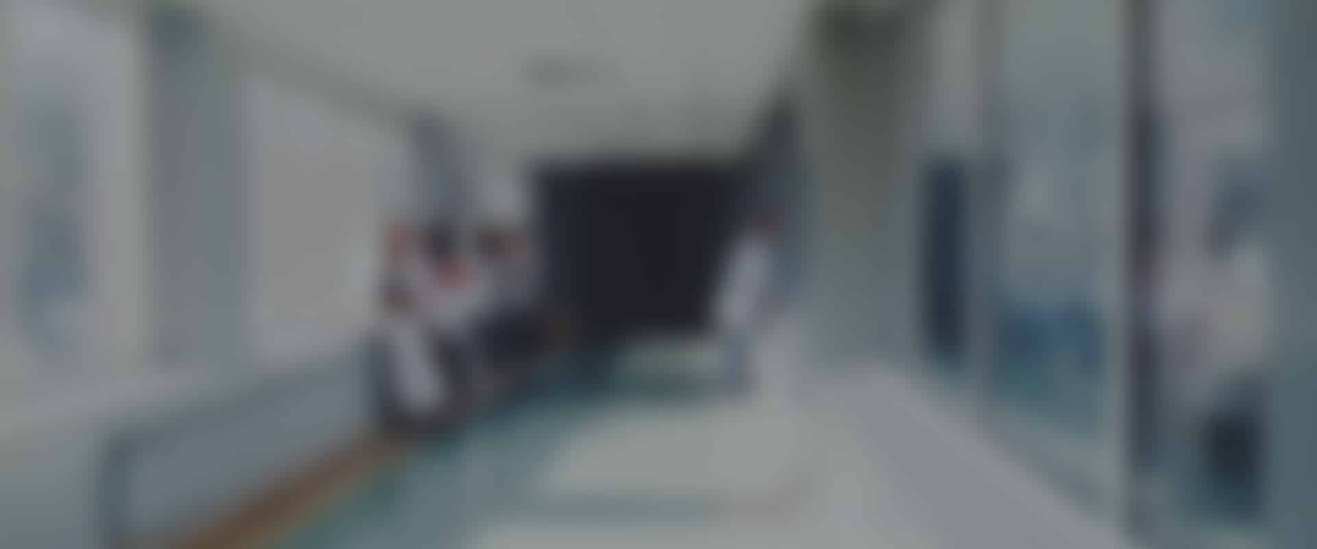 Blurred hospital corridor with doctors and nurses